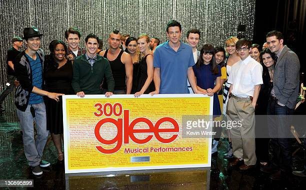 The cast of GLEE poses with a large plaque listing all 300 songs they've performed at the GLEE 300th musical performance special taping at Paramount...