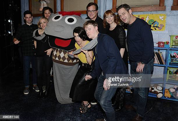 The cast of Hand to God Michael Oberholtzer Geneva Carr Bob Saget Sarah Stiles and Steven Boyer pose with guests on stage at 'Hand To God' at Booth...