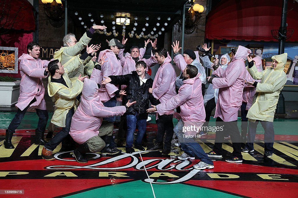 The cast of 'How to Succeed in Business Without Really Trying' including Daniel Radcliffe rehearse for the 85th annual Macy's Thanksgiving Day parade at Macy's Herald Square on November 22, 2011 in New York City.