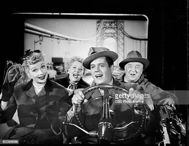 The cast of 'I Love Lucy' sits in a convertible with a backdrop of a suspension bridge behind them in an episode titled 'California, Here We Come!'...