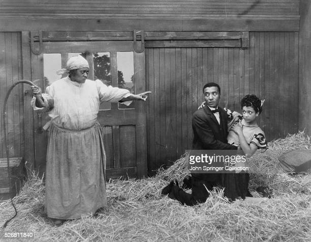 The cast of King Vidor's 1929 film Halleluja poses on the set From left to right Fanny Belle DeKnight as Mammy Johnson Daniel Haynes as Zekial Zeke...