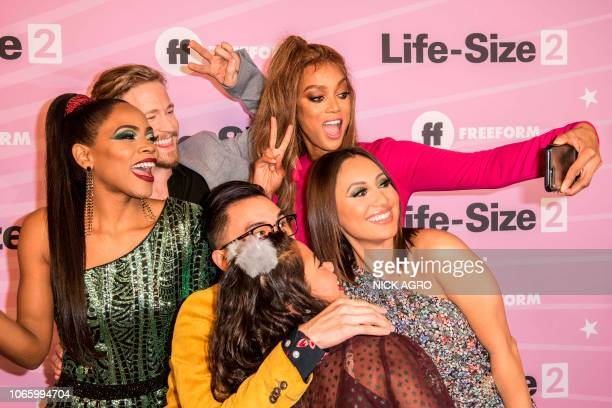 The cast of 'LifeSize 2' including model and actres Tyra Banks takes a selfie during the film's world premiere on November 27 2018 at The Hollywood...