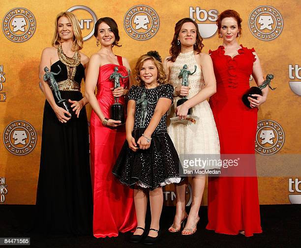 The cast of 'Mad Men' pose with their award for Outstanding Perforrmance by an Ensemble in a Drama Series in the press room of the 15th Annual Screen...