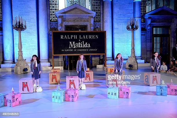 The cast of Matilda performs at the Ralph Lauren Fall 14 Children's Fashion Show in Support of Literacy at New York Public Library on May 19 2014 in...