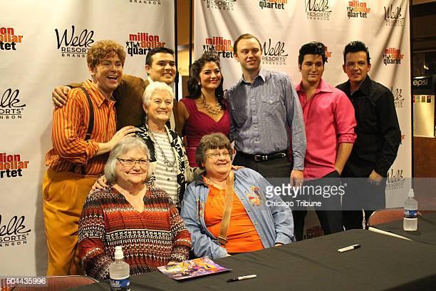 The cast of 'Million Dollar Quartet' David Brooks top from left Derek Garza Dana Parker Brad Waters Tyler K Hunter and Cliff Wright share a moment...