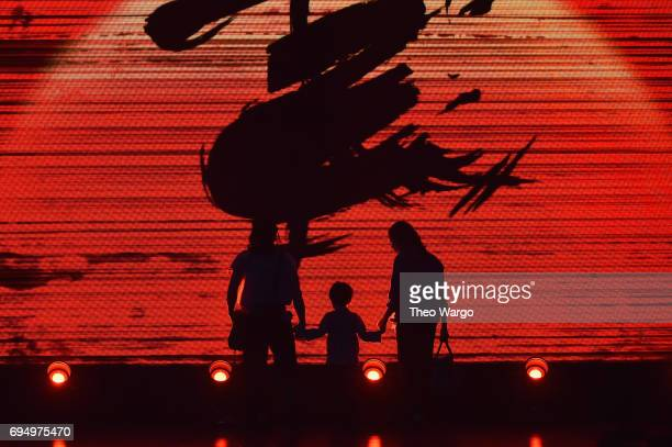 The cast of Miss Saigon performs onstage during the 2017 Tony Awards at Radio City Music Hall on June 11 2017 in New York City