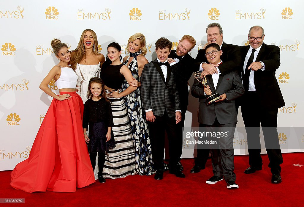 The cast of 'Modern Family' pose in the photo room with their award for Outstanding Comedy Series at Nokia Theatre L.A. Live on August 25, 2014 in Los Angeles, California.