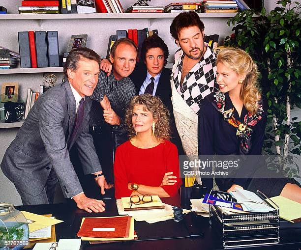 The cast of 'Murphy Brown' poses around Murphy's desk for a promotional photo, 1988. Clockwise from top left: Charles Kimbrough, Joe Regalbuto, Grant...
