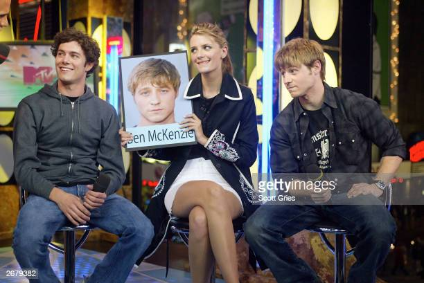The Cast of OC Adam Brody Mischa Barton and Benjamin McKenzie appear on stage during MTV's Total Request Live at the MTV Times Square Studios October...