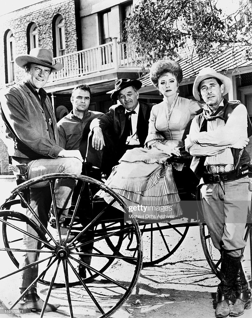 The cast of of TV's 'Gunsmoke' pose for a photo circa 1963