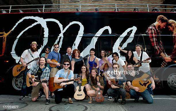 The cast of 'ONCE' perform in celebration of ONCE Week outside The Bernard B Jacobs Theatre on August 22 2013 in New York City