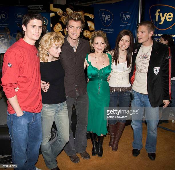 The cast of 'One Tree Hill' poses during an appearance at the FYE music store to sign CD's of the show soundtrack January 25 2004 in New York City