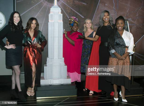 The cast of Orange Is The New Black Laura Prepon Danielle Brooks Dascha Polanco Uzo Aduba and Laverne Cox at the Empire State Building on July 26...