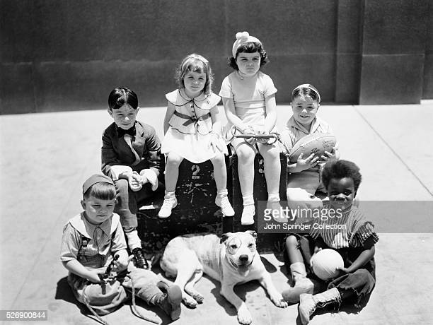 The cast of 'Our Gang/Little Rascals' TV show Hal Roach MGM production Spanky McFarland holding the football Undated photograph