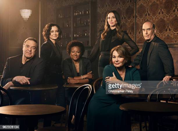 The cast of Roseanne from left to right John Goodman Sara Gilbert Wanda Sykes Whitney Cummings Roseanne Barr and producer Bruce Helfrod are...