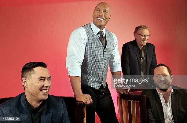 The cast of 'San Andreas' Dwayne 'The Rock' Johnson Carlton Cuse Brad Peyton and Beau Flynn are photographed for Los Angeles Times on May 16 2015 in...