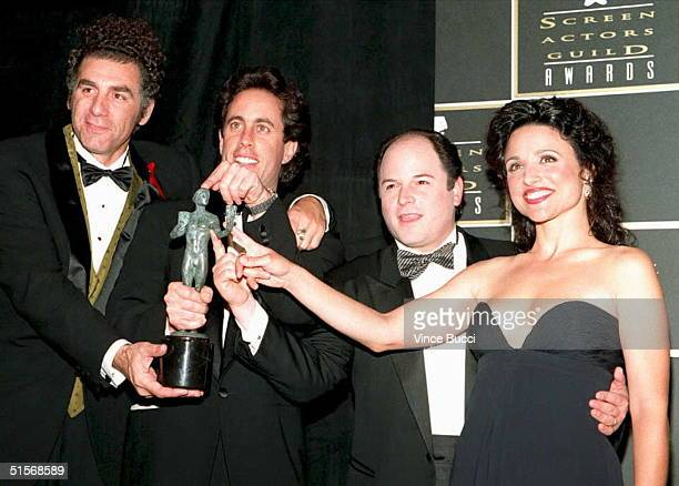 The cast of Seinfeld plays with the award they won for outstanding ensemble performance in a comedy series during the Inaugural Screen Actors Guild...