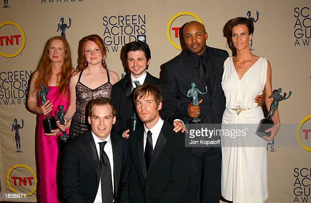 The cast of Six Feet Under pose backstage with their Outstanding Performance by an Ensemble in a Drama Series award during the 9th Annual Screen...