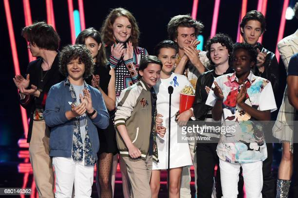 The cast of 'Stranger Things' accepts Show of the Year onstage during the 2017 MTV Movie And TV Awards at The Shrine Auditorium on May 7 2017 in Los...