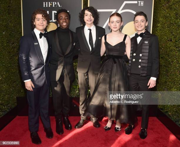The cast of Stranger Things Gaten Matarazzo Caleb McLaughlin Finn Wolfhard Sadie Sink and Noah Schnapp attend The 75th Annual Golden Globe Awards at...