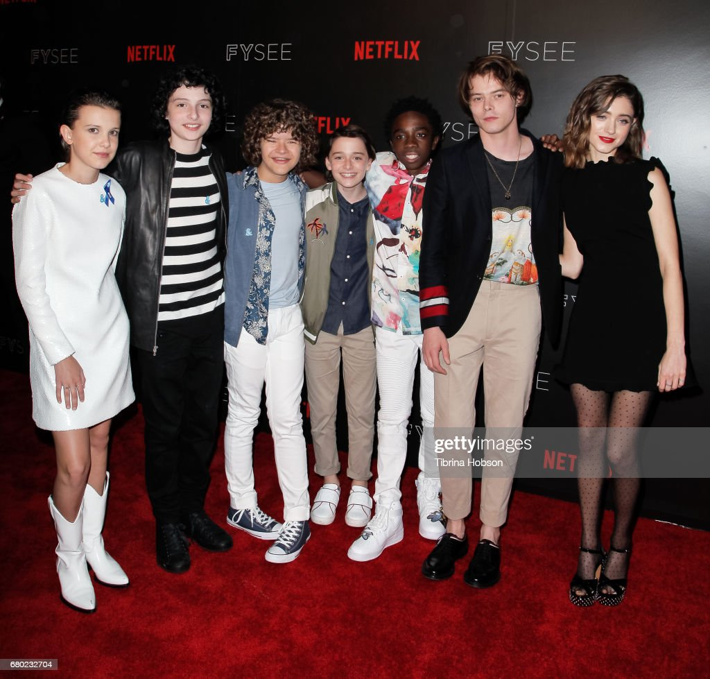 The cast of Stranger Things, (L-R) Millie Bobby Brown, Finn Wolfhard, Gaten Matarazzo, Noah Schnapp, Caleb McLaughlin, Charlie Heaton and Natalia Dyer attend the Netflix FYSEE Kick-Off event at Netflix FYSee Space on May 7, 2017 in Beverly Hills, California.