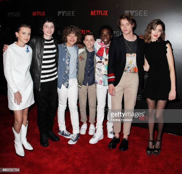 The cast of Stranger Things Millie Bobby Brown Finn Wolfhard Gaten Matarazzo Noah Schnapp Caleb McLaughlin Charlie Heaton and Natalia Dyer attend the...