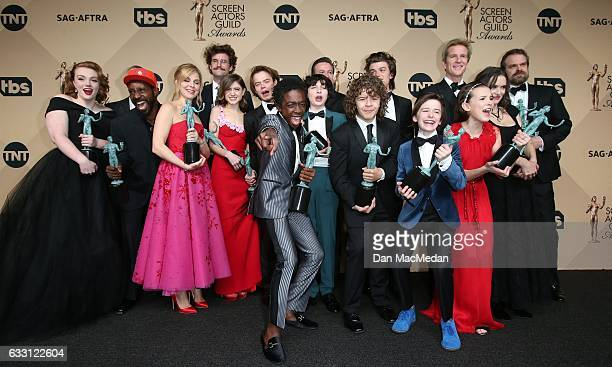 The cast of 'Stranger Things' pose in the press room with their award for Outstanding Performance by an Ensemble in a Drama Series at the 23rd Annual...