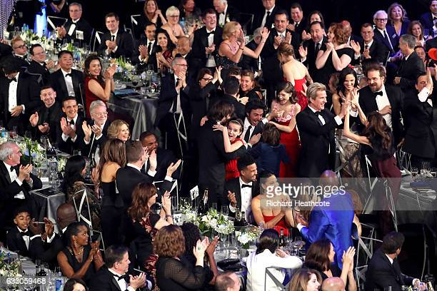 The cast of Stranger Things reacts in the audience to being announced the winners of the Outstanding Performance by an Ensemble in a Drama Series...