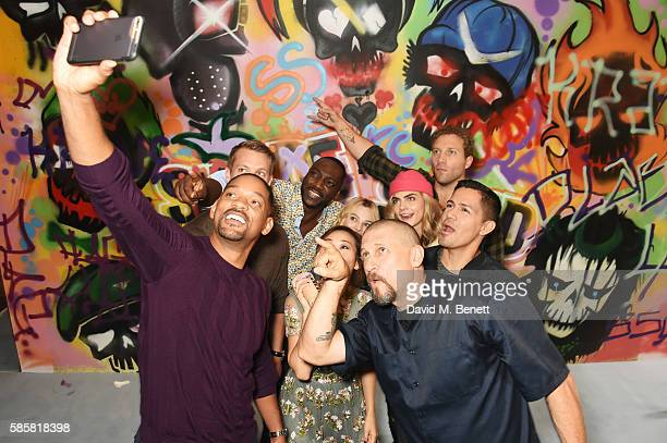 "The cast of ""Suicide Squad"" including Will Smith, Joel Kinnaman, Adewale Akinnuoye-Agbaje, Karen Fukuhara, Margot Robbie, Cara Delevingne, Jai..."