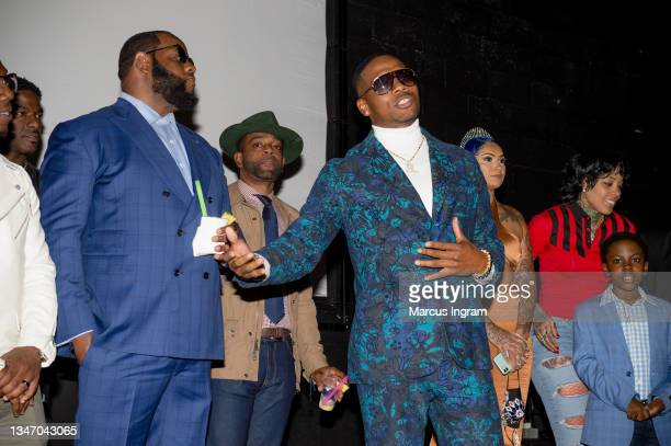 """The cast of Super Turnt on stage during the """"Super Turnt"""" movie premiere at Mann Robinson Studios on October 16, 2021 in Atlanta, Georgia."""