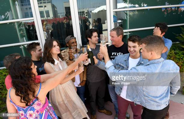 The cast of 'Teen Wolf' celebrate their final season backstage after their Hall H panel during ComicCon International 2017 at San Diego Convention...