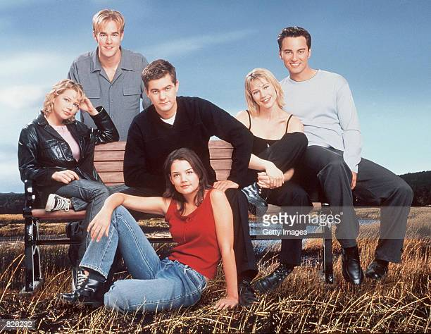 The cast of television's Dawson's Creek poses for a photo James Van Der Beek stand in the back row In the middle row from left to right are Michelle...
