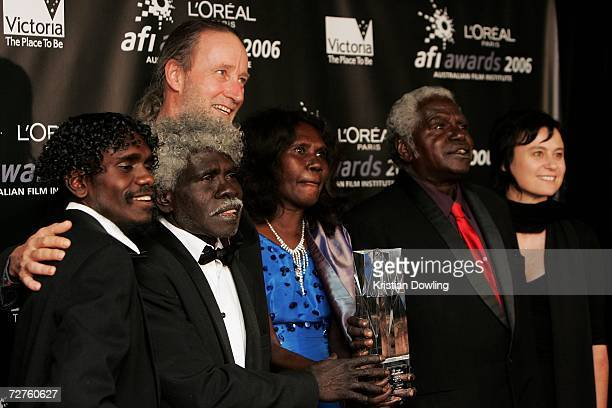 The cast of Ten Canoes including Jamie Gulpilil Rolf de Heer Frances Djulibing and Julie Ryan pose with the L'Oreal Paris AFI Award for Best Film for...