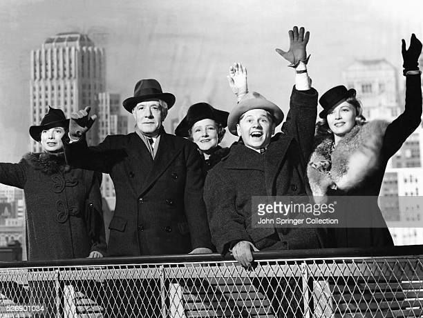 The cast of the 1940 musical Andy Hardy Meets Debutante waving from a studio recreation of New York Left to right are Sara Haden as Aunt Milly Lewis...