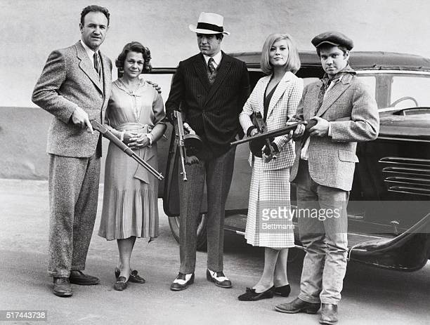 The cast of the 1967 film Bonnie and Clyde posing with guns From left to right actor Gene Hackman as Buck Barrow actress Estelle Parsons as Blanche...