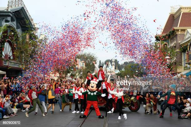 The cast of the allnew Club Mickey Mouse performs a sparkling holiday number on Main Street USA at Disneyland Park during a taping of Disney Parks...
