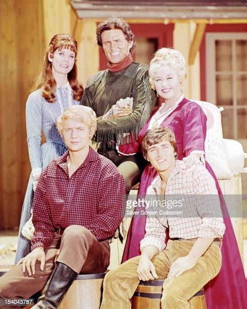The cast of the American comedy western TV series 'Here Come The Brides' circa 1969 Standing left to right Bridget Hanley Robert Brown and Joan...