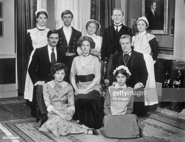 The cast of the British drama television series Upstairs Downstairs back row left to right Jean Marsh Christopher Beeny Angela Baddeley Gordon...