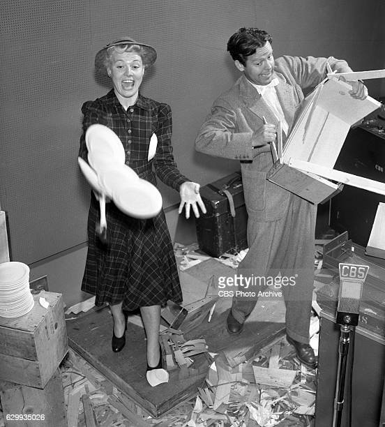 The cast of the CBS Radio program Blondie featuring Penny Singleton and Arthur Lake They smash wooden crates and boxes to simulate the sound of their...