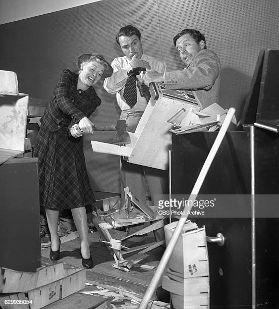 The cast of the CBS Radio program Blondie featuring Penny Singleton Hanley Stafford and Arthur Lake They smash wooden crates and boxes to simulate...