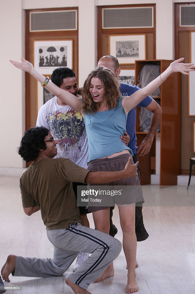 The cast of the celebrated musical Hair, produced by Antonie Redon, rehearses at the Ravi Shankar Institute of Music and Performing Arts in New Delhi on April 21, 2010.