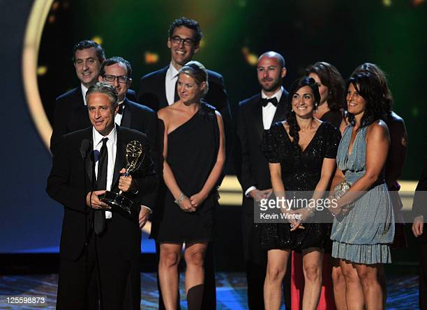 The cast of The Daily Show With Jon Stewart accept the Outstanding Variety Music Or Comedy Series award onstage during the 63rd Annual Primetime Emmy...