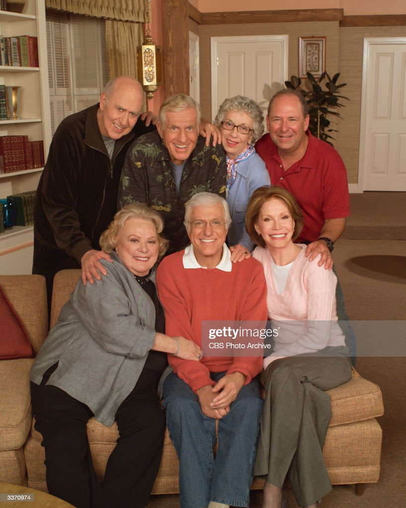 The cast of 'The Dick Van Dyke Show Revisited' pose for a portrait on the set, Los Angeles, California, March 30, 2004. Left to right, standing, American actors Carl Reiner, Jerry Van Dyke, Ann Morgan Guilbert, and Larry Matthews. Left to right, sitting, American actors Rose Marie, Dick Van Dyke, Mary Tyler Moore.