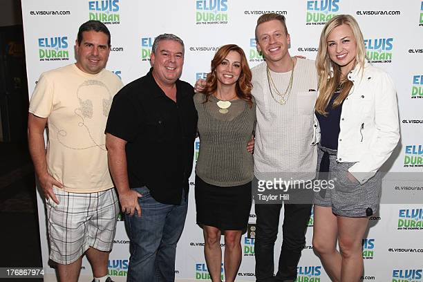 The cast of The Elvis Duran Z100 Morning Show poses with Macklemore at Z100 Studio on August 16 2013 in New York City