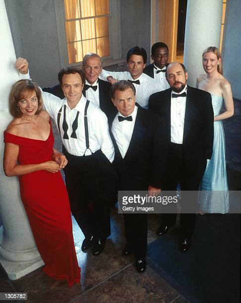 The cast of the Emmy awardwinning drama series The West Wing poses for a publicity photo In the front row from left to right are Allison Janney...
