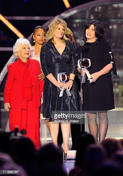 """The cast of """"The Facts Of Life"""" Charlotte Rae, Kim Fields, Lisa Whelchel and Nancy McKeon accept the Pop Culture Award onstage at the 9th Annual TV..."""