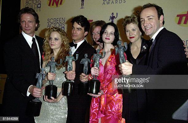 The cast of the film 'American Beauty' Chris Cooper Mena Suvari Peter Gallagher Allison Janney Thora Birch Annette Bening and Kevin Spacey hold the...