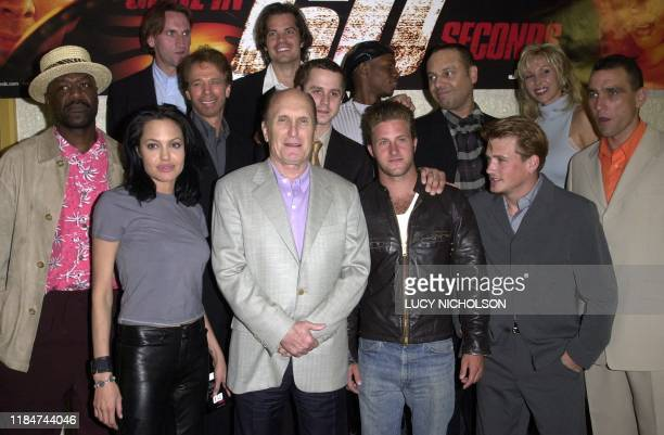 The cast of the film Gone in 60 Seconds pose at the film's premiere in Los Angeles 5 June 2000 Angelina Jolie Robert Duvall Scott Caan William Lee...