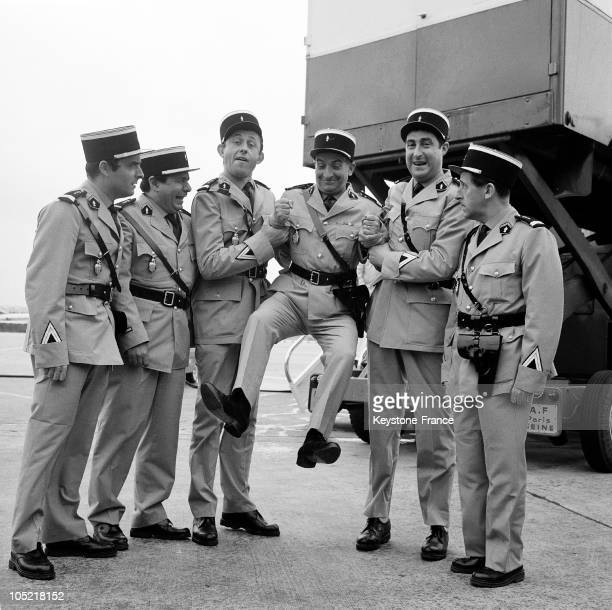 The Cast Of The Film Le Gendarme De Saint Tropez At Orly Upon Returning From Nice. From Left To Right: Guy Grosso, Michel Galabru, Christian Marin,...