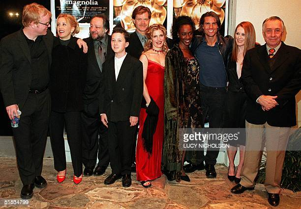 The cast of the film Magnolia poses at the film's premiere in Los Angeles 08 December 1999 actor Philip Seymour Hoffman and his unidentified wife...